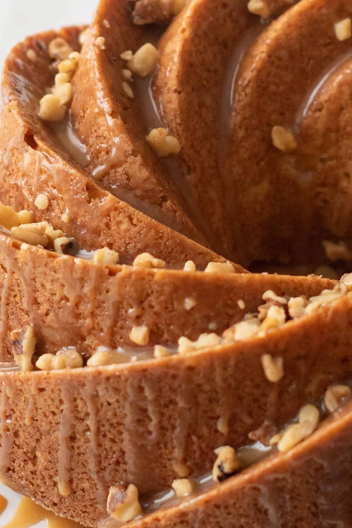 Close up of Bailey's cake. Bundt swirls, glaze topping and walnut pieces.