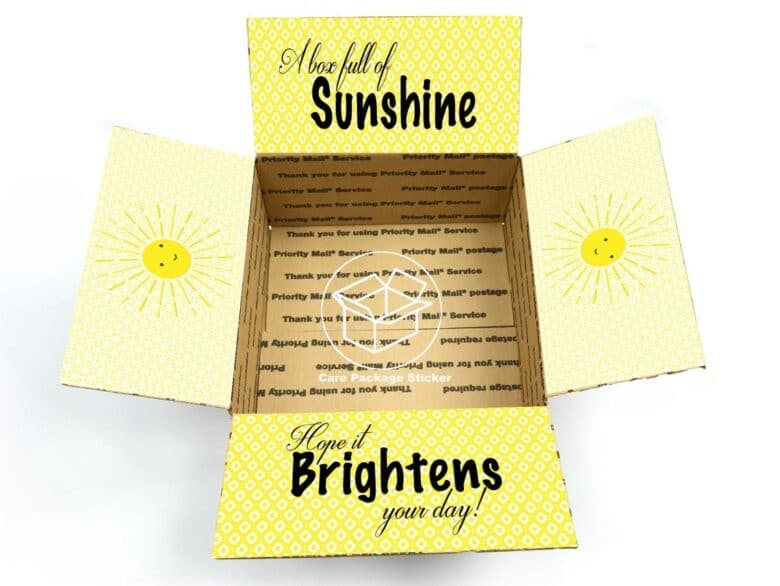 Open box with A box full of sunshine brightens your day written on the flaps.