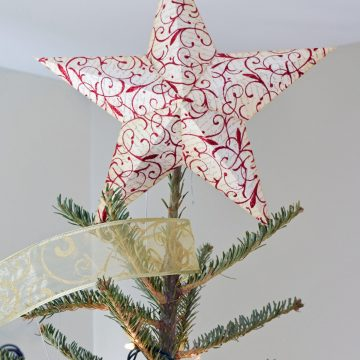 Paper 3-D star atop tree. Star is stamped red and white with glitter.