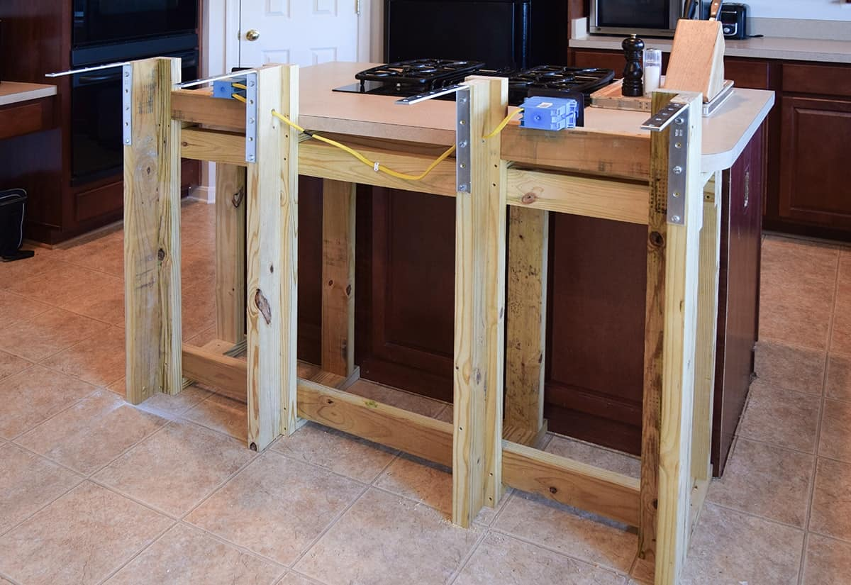 We wanted to add a breakfast bar to the kitchen island and make it bigger. This is the frame and electrical wiring we added to the existing kitchen island.