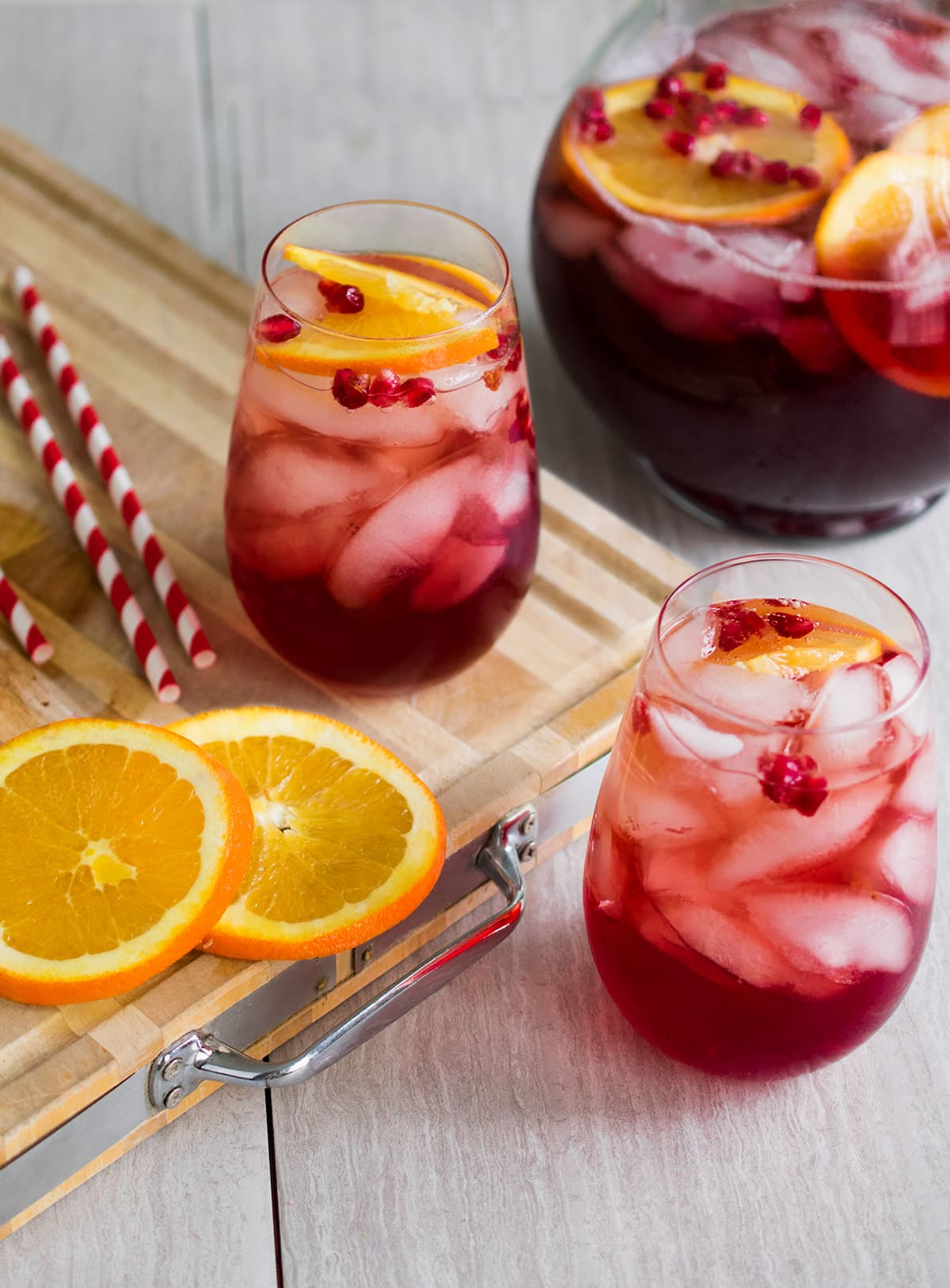 Holiday Punch recipes - Simple Christmas punch idea with alcoholic cocktail and nonalcoholic punch versions. This cocktail is loaded with cranberry, pomegranate, and citrus orange flavors, and then topped with a little fun fizz, it is sure to be a favorite at your holiday party.