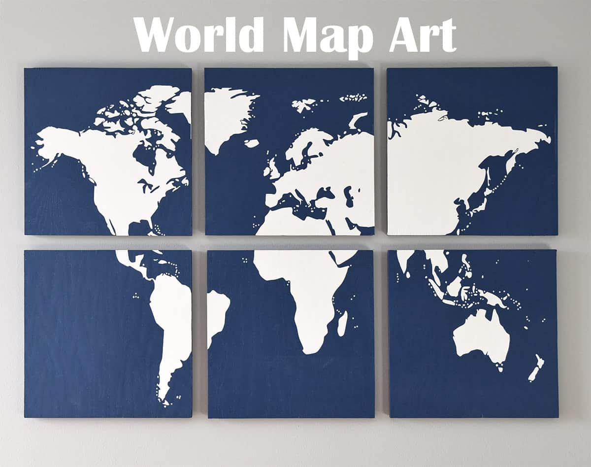 DIY World map wall art on gray wall with blue sectioned pieces with white map silhouette.