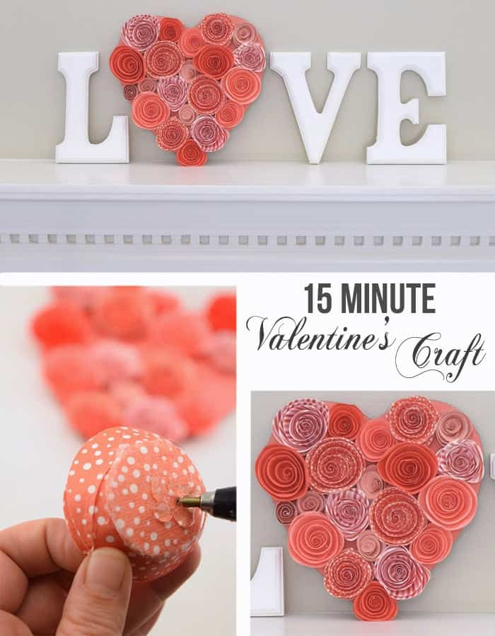 White lettered Valentine's day mantle decor with love message and pink paper flower heart.