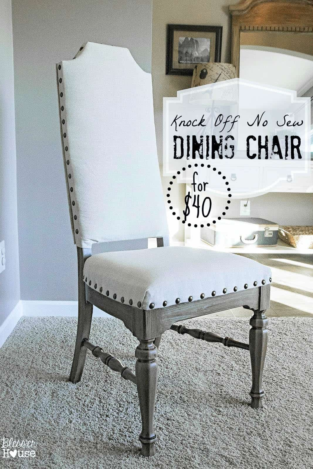 Refinished dining room chair with no-sew studded white upholstery and gray wooden base and legs on carpeted floor.