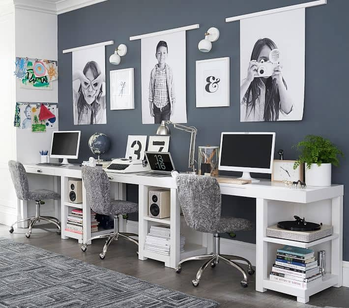 Office for 3 kids with photos above the desks.