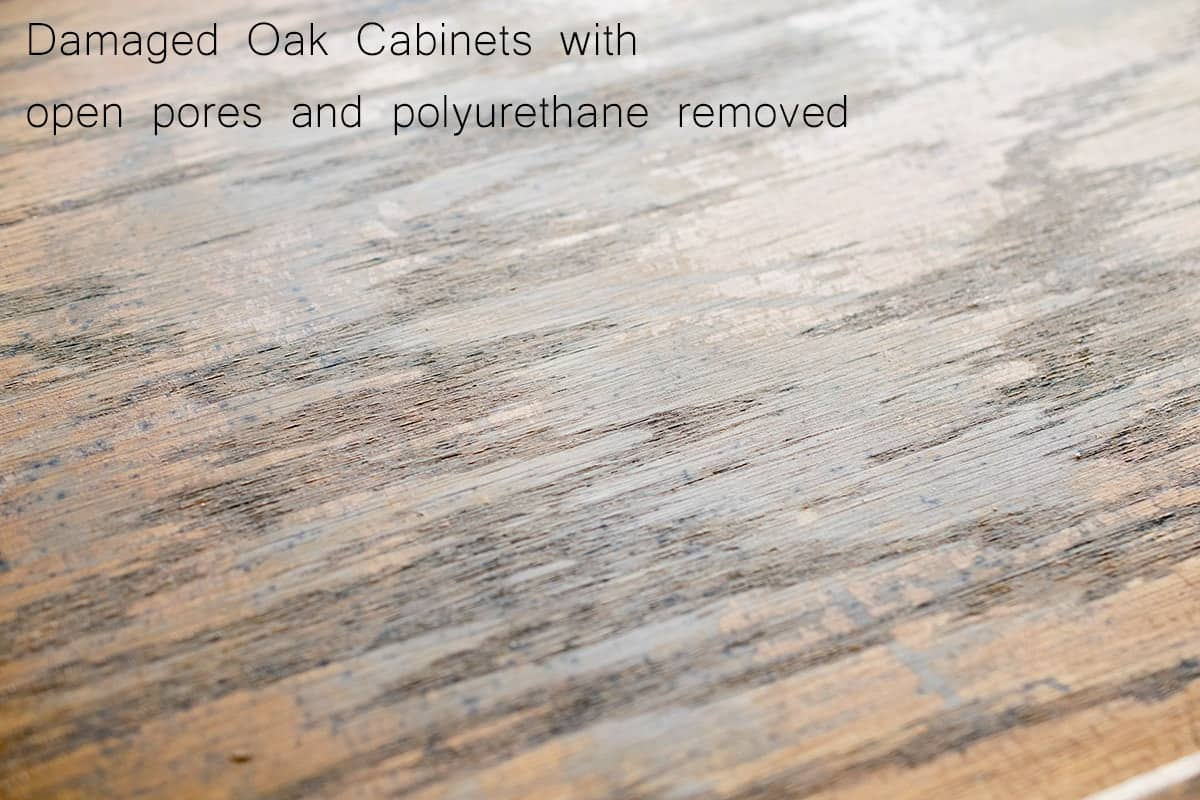Closeup detail of wood grain in old oak wood cabinet with gloss coating removed.