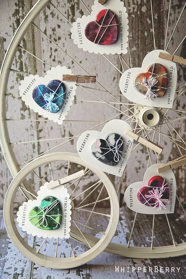 Melted Crayon Heart valentines clothes-pinned to antiqued bicycle wheel
