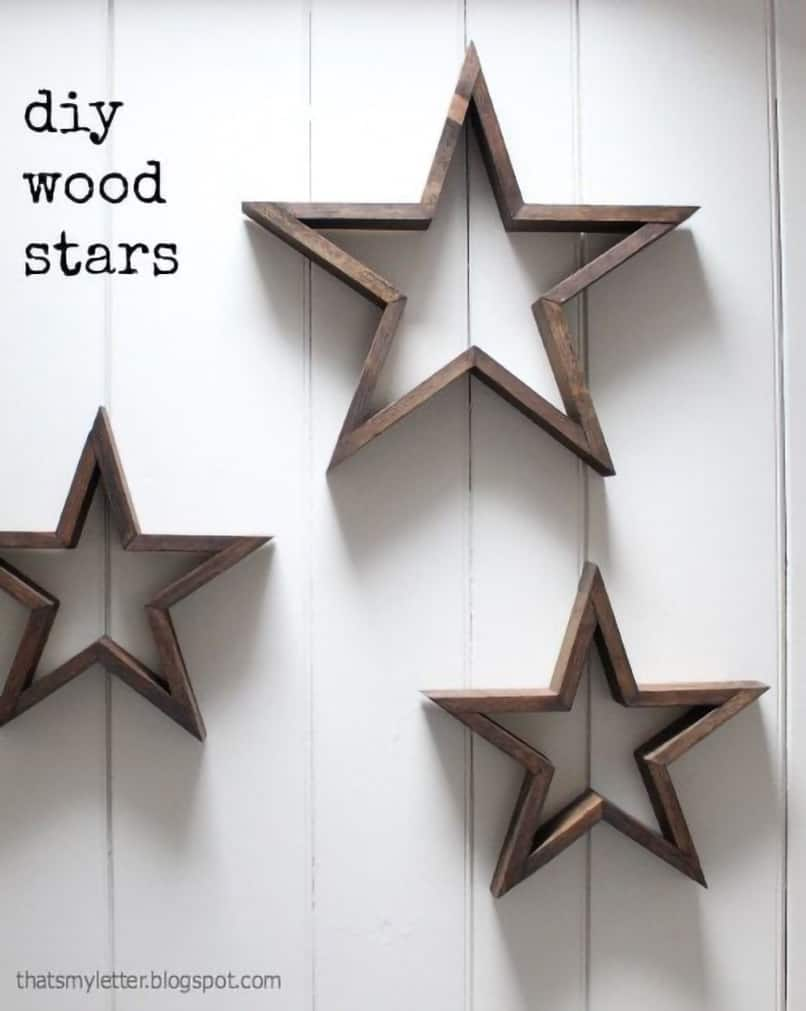 3-D star outline shaped wall art on white panelled wall.