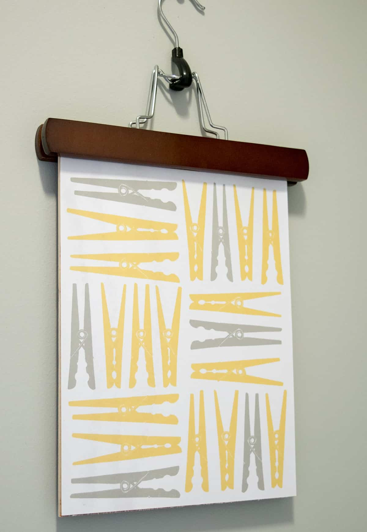 Laundry-Room-Clothespin-Art-with-Antique-Pants-Hanger