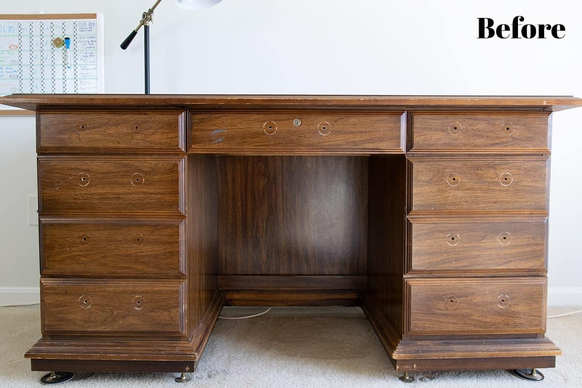 Antique desk before DIY makeover with hardware removed.