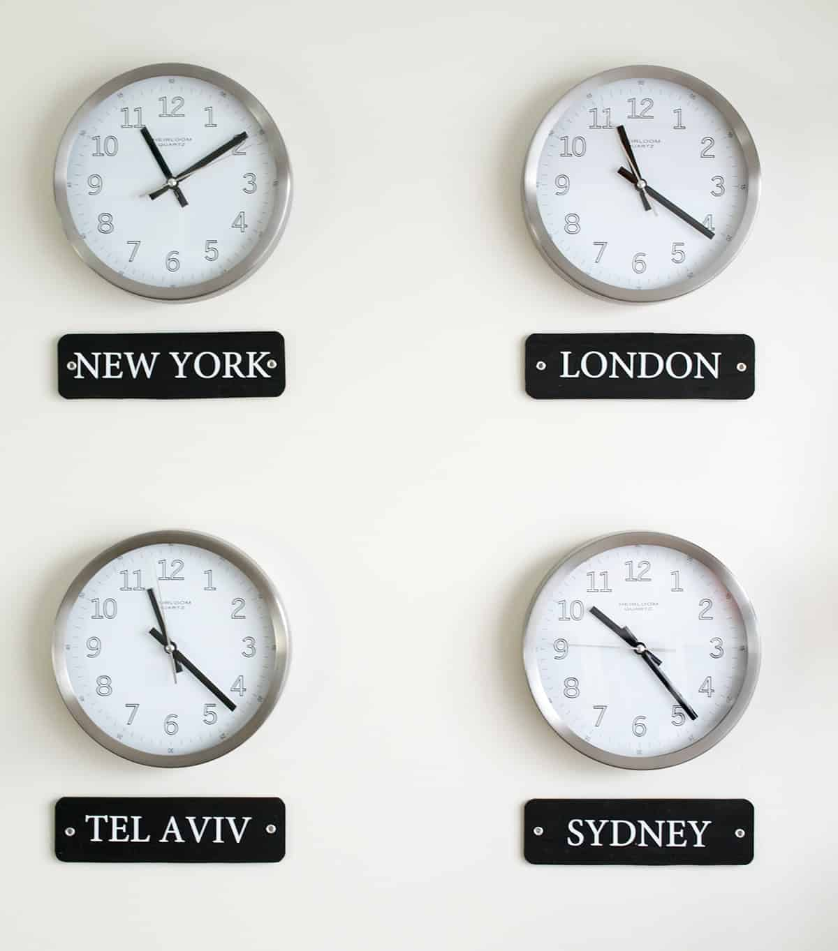 International World Clock Wall Display with black mounted city name labels underneath.