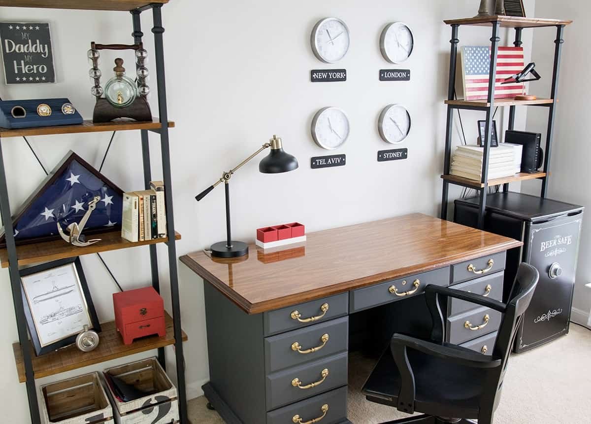 Masculine Office with Patriotic decor theme. World Wall clocks, Antique desk in Telegram gray, and Americana decorations on the shelves.
