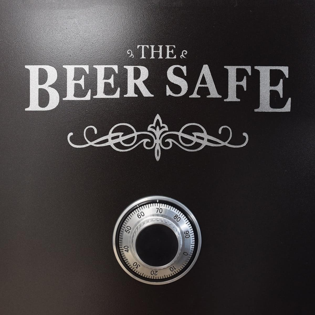 Close up of beer safe stencil detail on black mini fridge with authentic safe dial.
