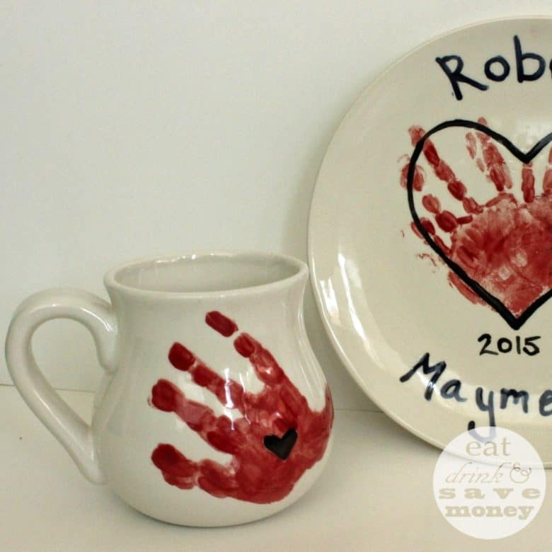 Hand painted pottery gift for mom with red handprints, hearts, and kid's names.