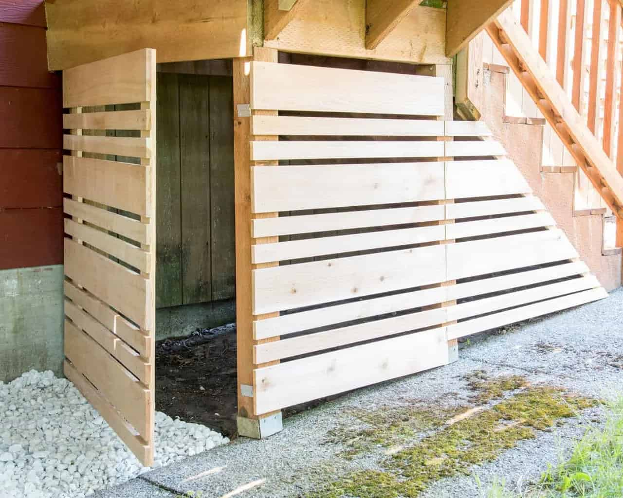 Under stair section of a deck covered with a removeable panel.