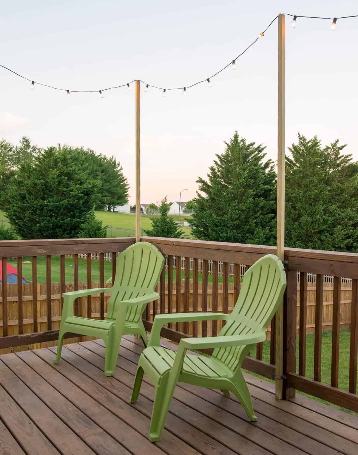 A super easy DIY way to hang outdoor string lights when you don't have a covered deck or pergola. The warm summer nights on your deck with this lighting will create the perfect ambiance for a party or enjoying the sunset.