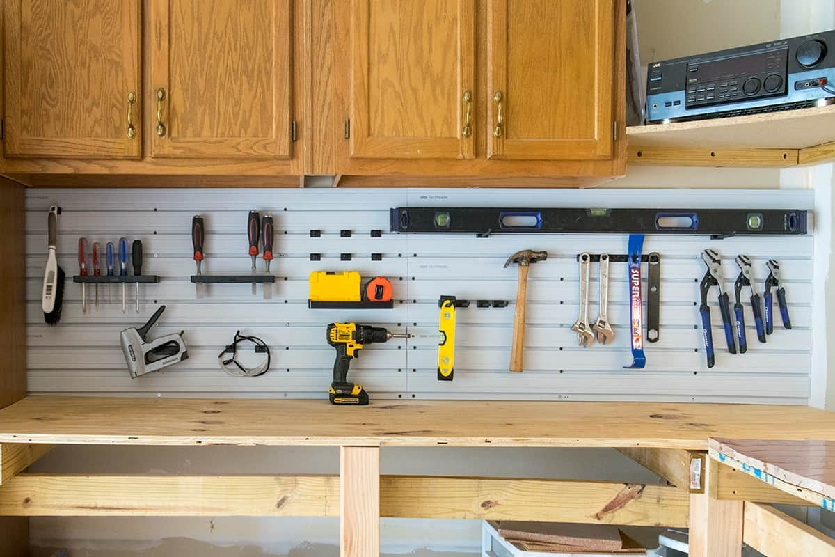 Garage Tool Organization with Rubbermaid FastTrack Wall Panels. Tools are accessible and easy to find.
