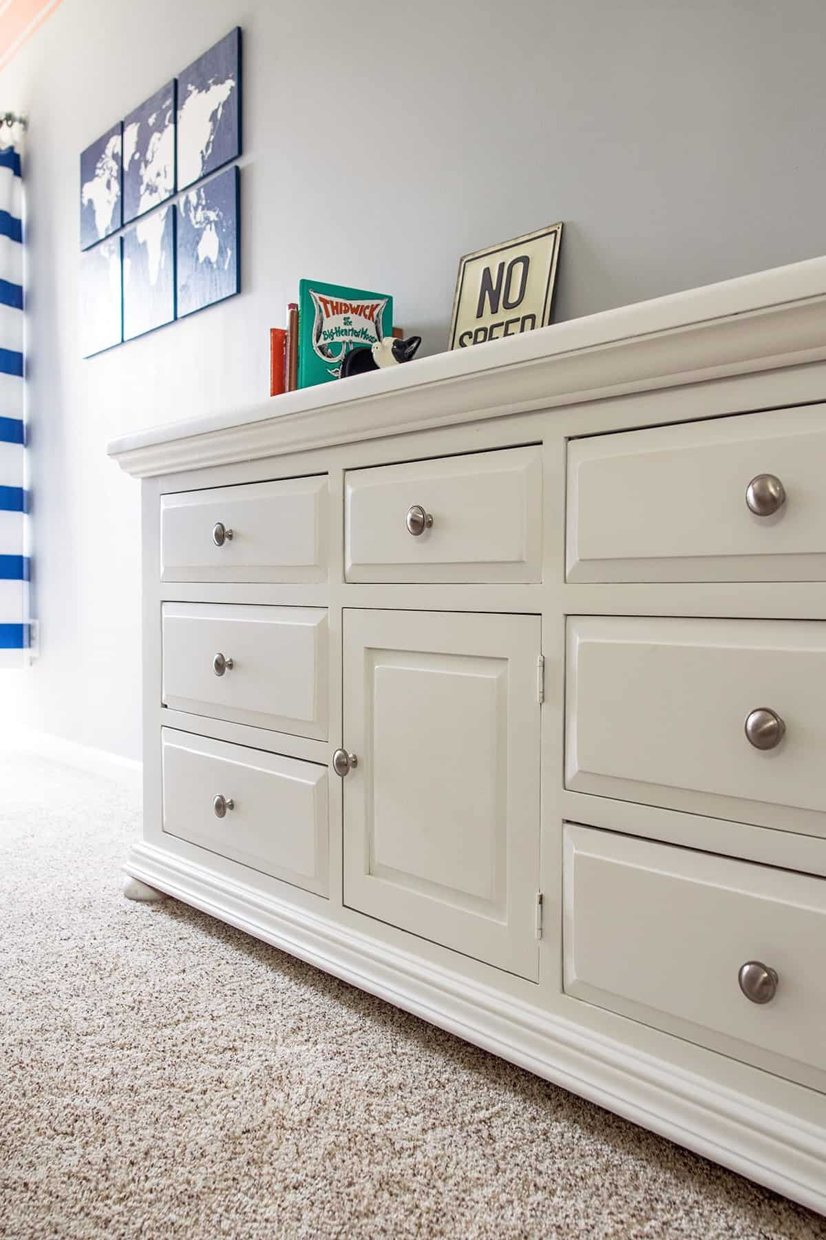 DIY Dresser Makeover from an old pine dresser. New Hardware and painted dresser with furniture paint to create a modern, updated dresser.