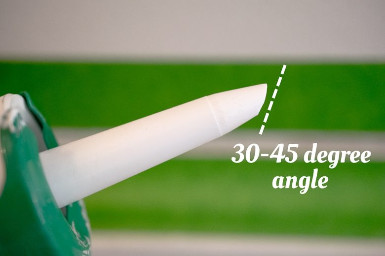 caulking gun with caulking tip cut at a 30-45 degree angle for easier application.