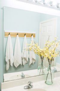 Bathroom Shelf Makeover with DIY towel rack. Get a spa look and great organization with a spa feel.