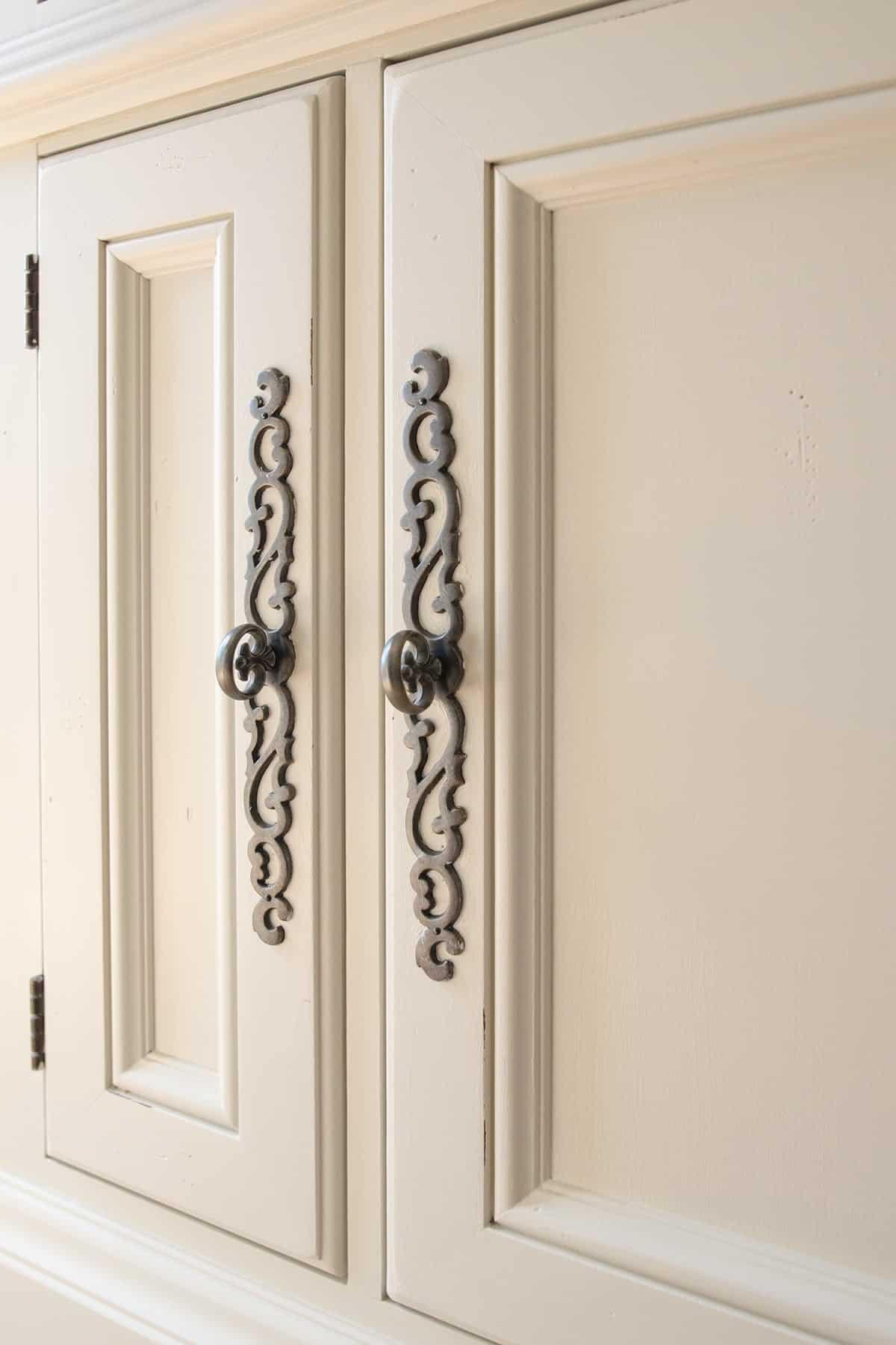 doors-with-ornate-handles-entertainment-center-hooker