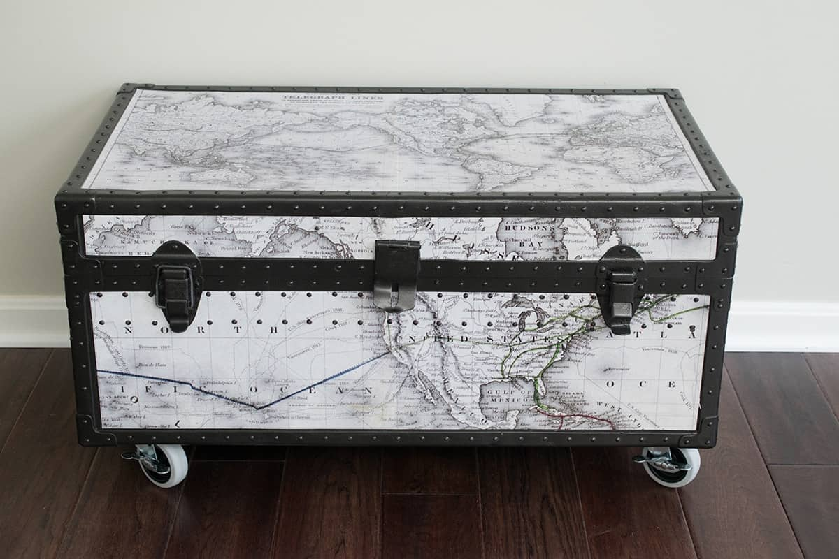 Antique Trunk Makeover - A beat up old military trunk gets a fresh start with a customized world map, casters, and spray paint. Stripping the paint of the metal was the hardest part.