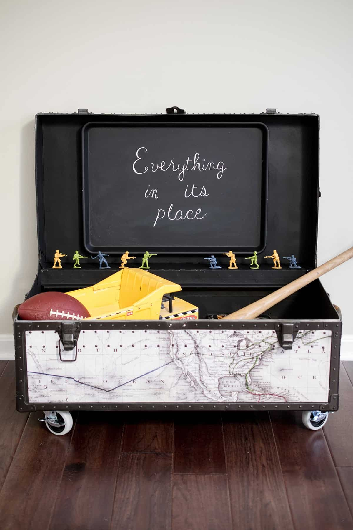 paint furniture- Antique Trunk Makeover - A beat up old military trunk gets a fresh start as storage with a customizeable world map, casters, and spray paint. Stripping the paint of the metal was the hardest part.