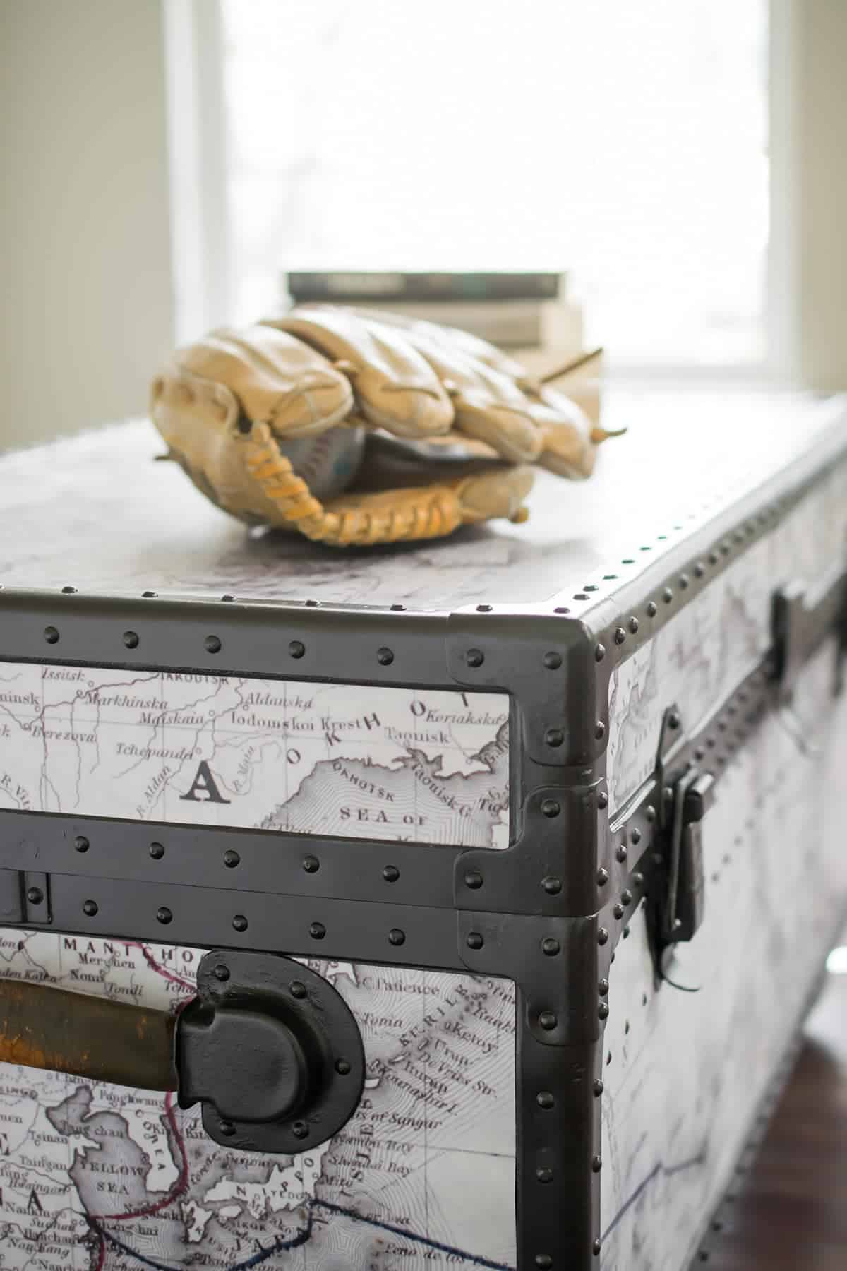 paint furniture- Antique Trunk Makeover - A beat up old military trunk gets a fresh start with a customizeable world map, casters, and spray paint. Stripping the paint of the metal was the hardest part.