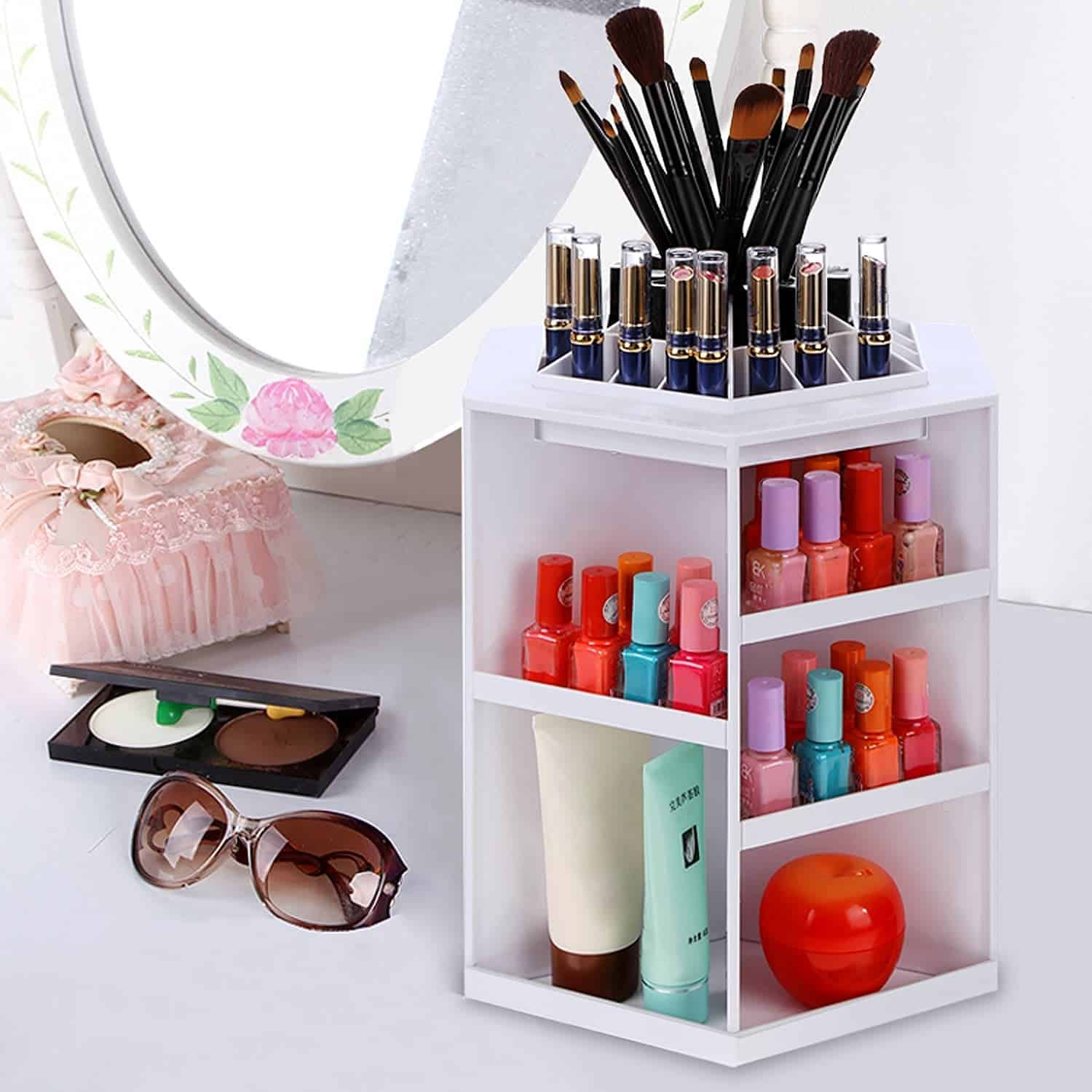 White rotating makeup organizer with assorted nail polishes, liptsticks, and brushes on vanity