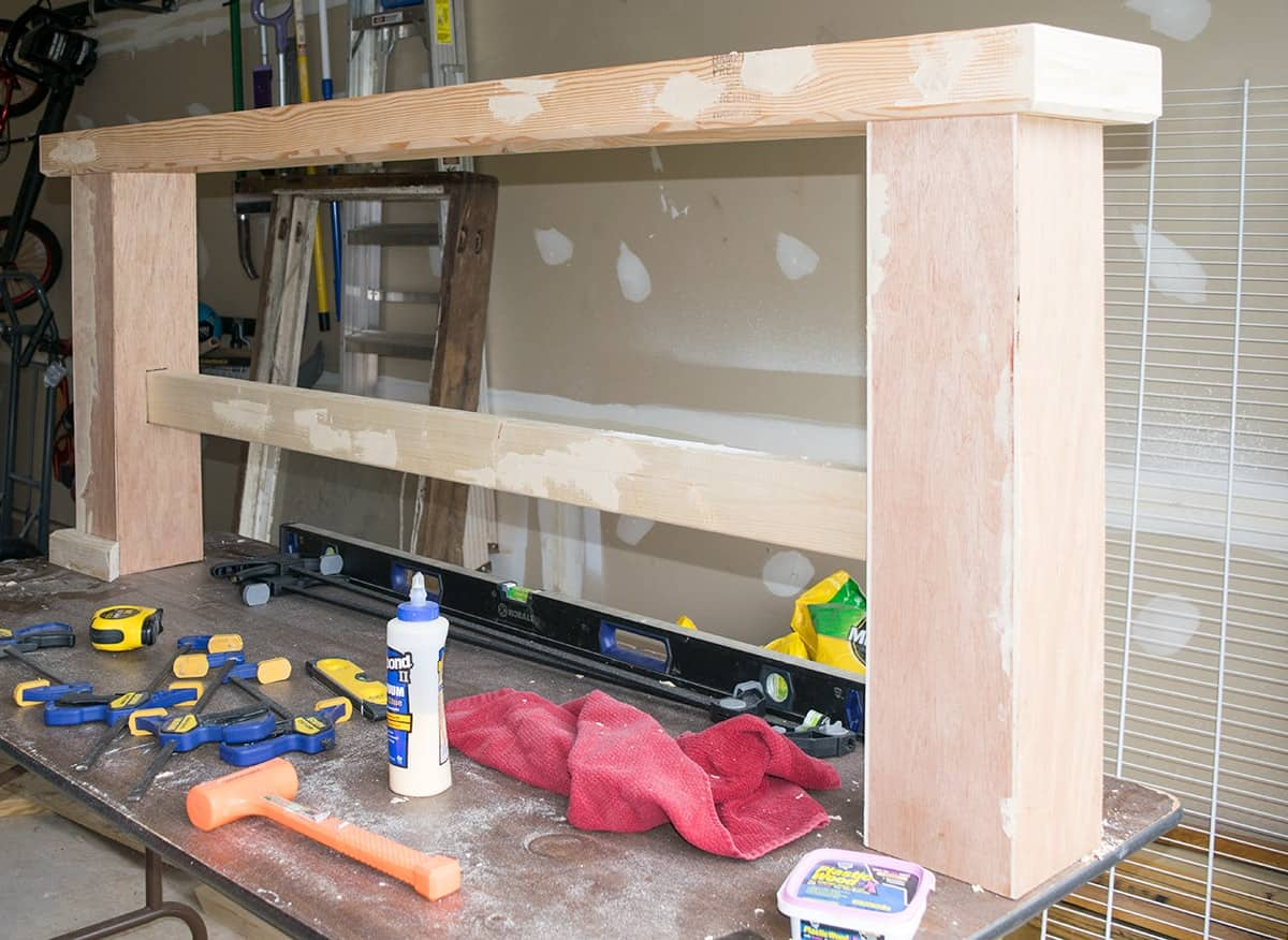 Progress of building a console table and using wood filler to fill in holes