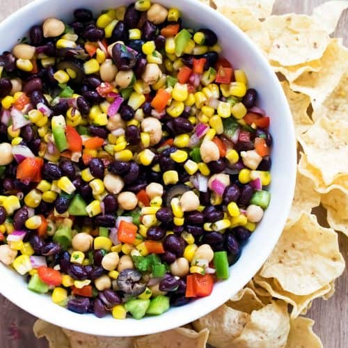 This delicious corn and black bean salad packs a healthy punch with lots of vegetables and a fresh cilantro dressing. It is bursting with fresh and filling flavor!