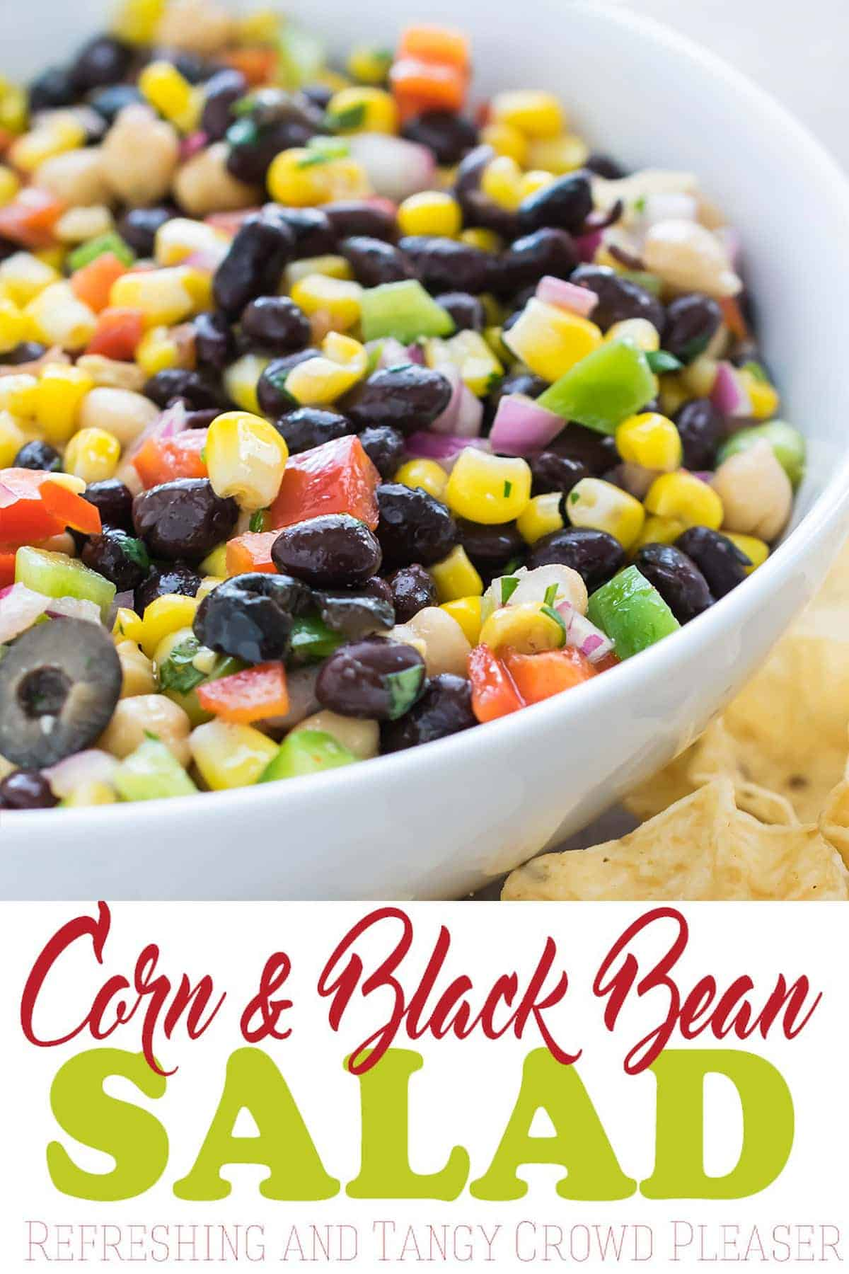 Light and flavorful Cilantro black bean and corn salsa in large white bowl served with scoop style tortilla chips