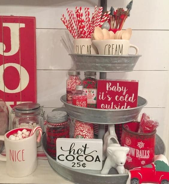 Christmas Coffee or Hot Cocoa Bar using 3 tiered tray with assorted items used for making festive cocoa.