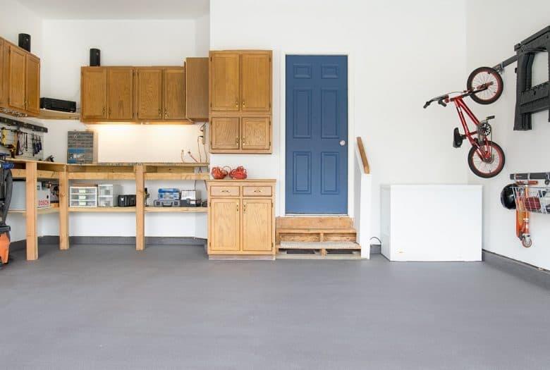 Residential garage floor with non-slip coating applied using Behr Premium Granite Grip.