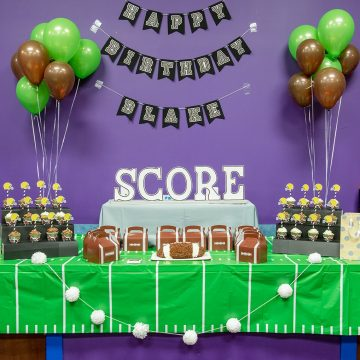 Boy's Football Birthday Party Dessert bar with favors and stadium cupcake stands