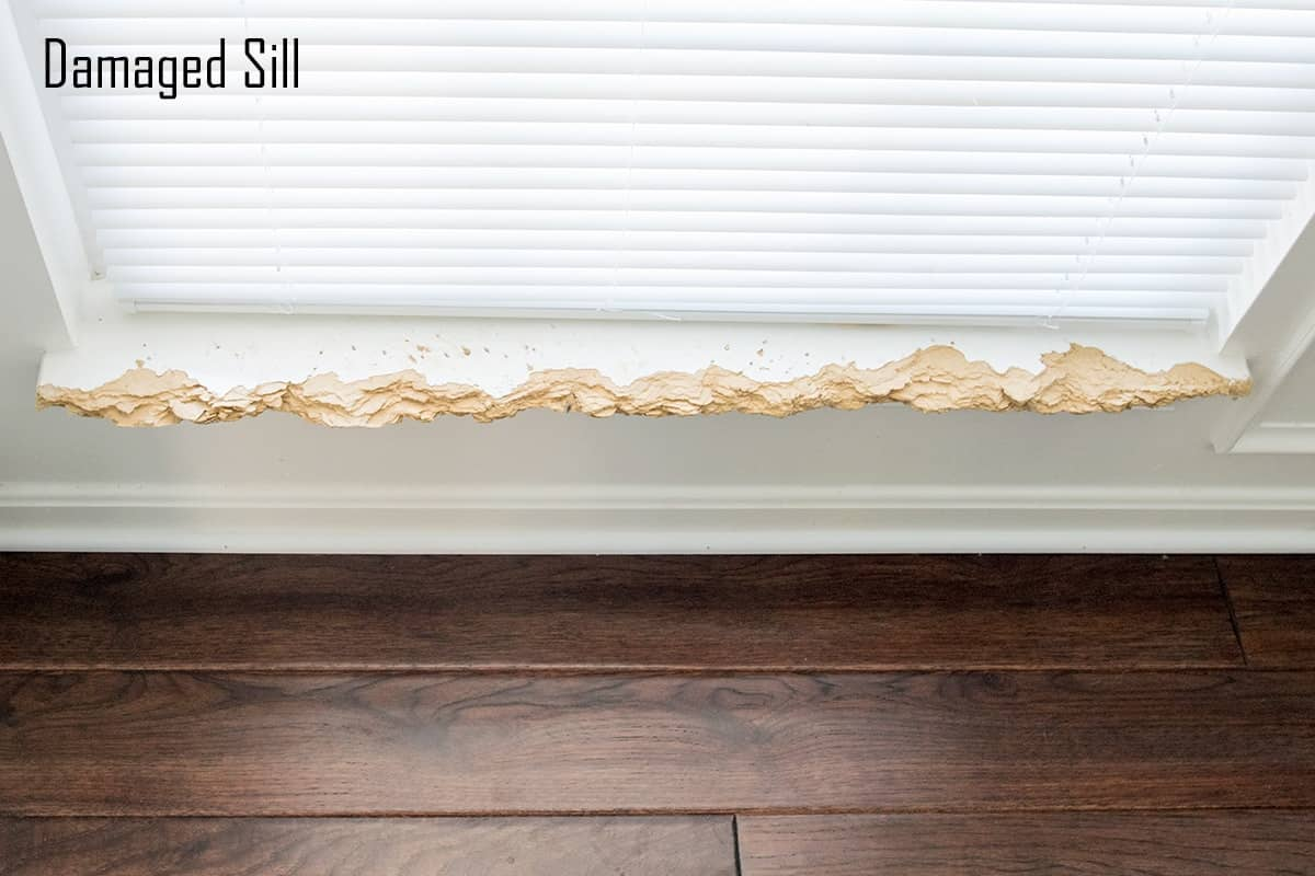 Damaged wood window sill before repair