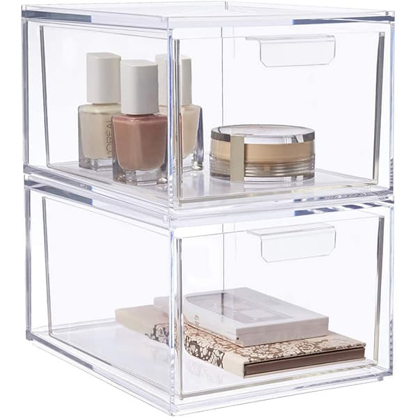 Clear plastic stackable drawers with makeup in each drawer.