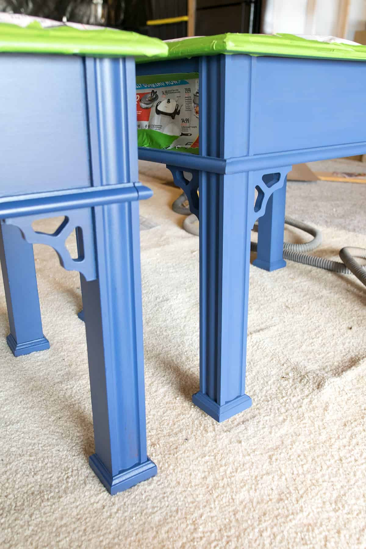 Difference in sheen for flat versus satin finish on two blue side tables