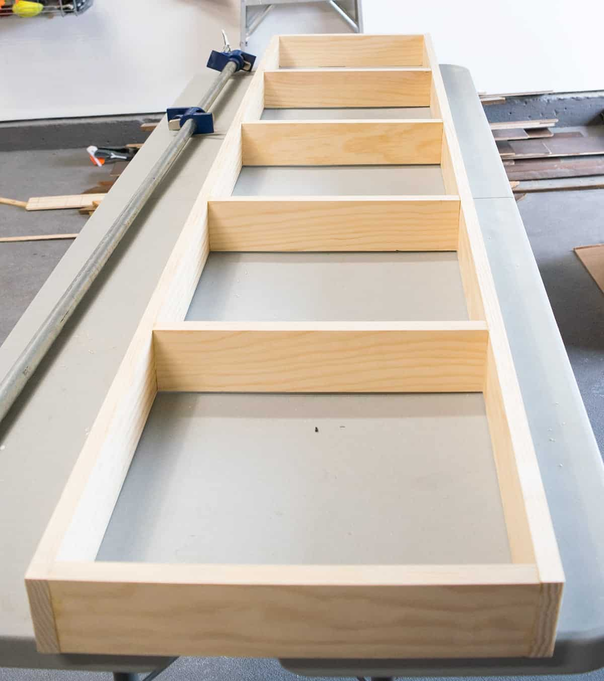 Frame for built-in bookshelf laying flat on table