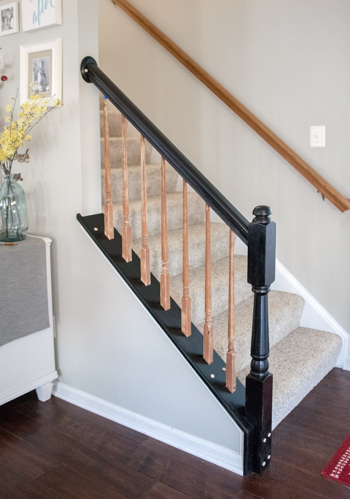 In progress of painting oak wood stairwell with a new, black finish
