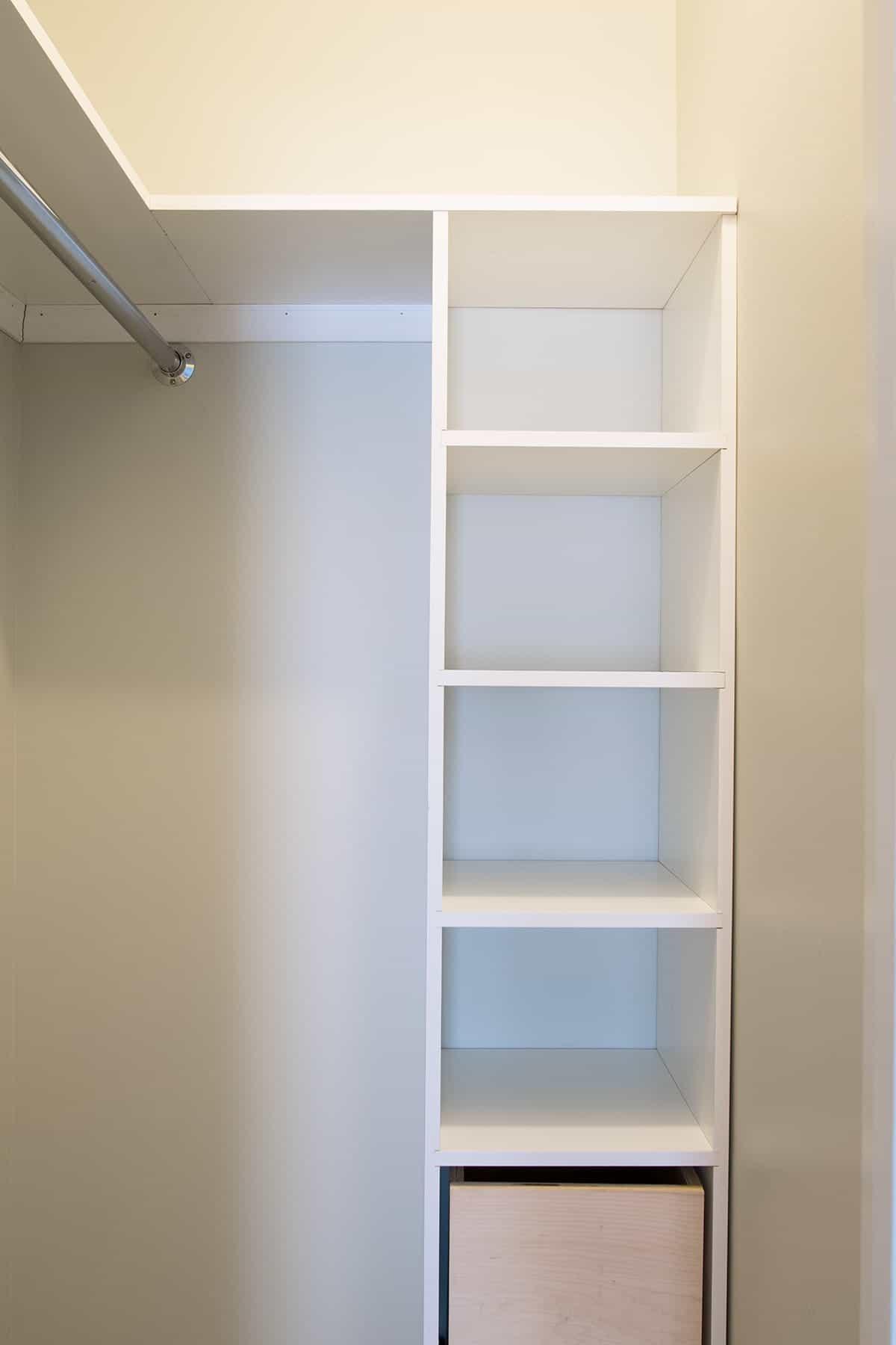 Custom built white shelves in kids bedroom for extra storage