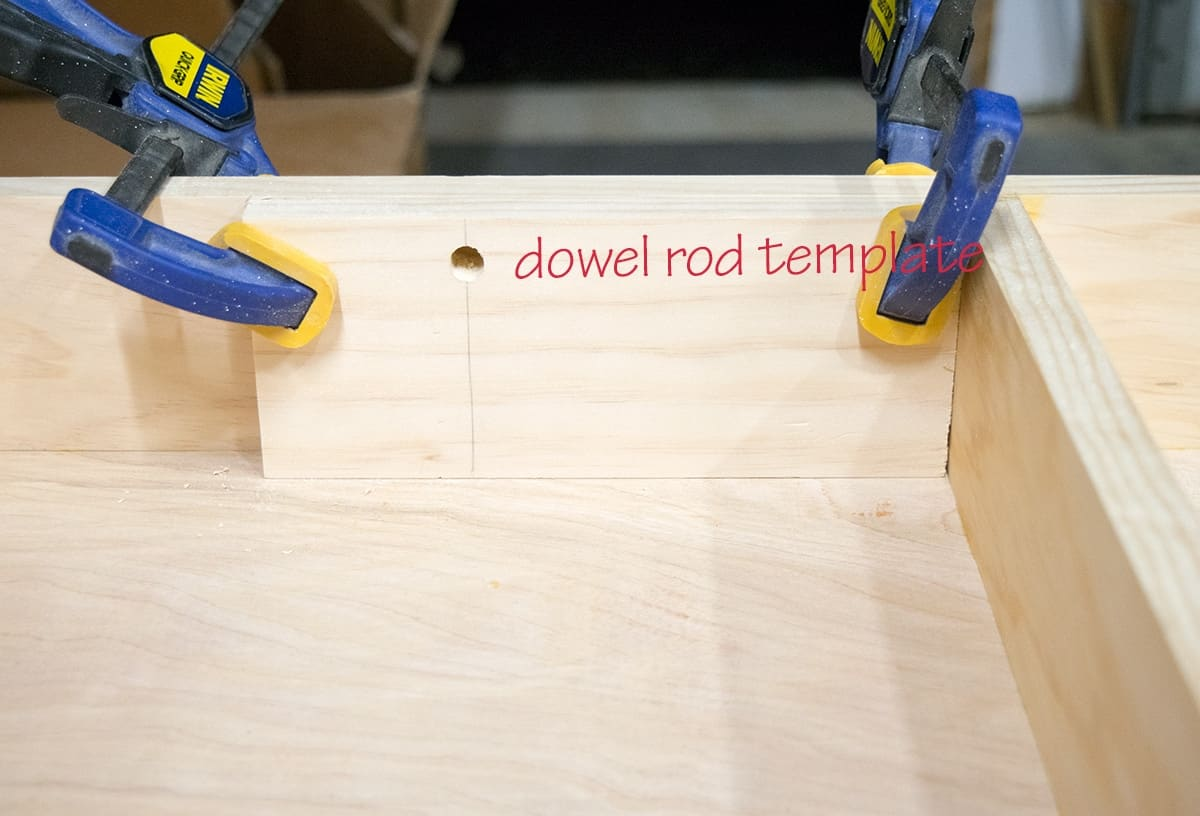 Dowel rod jig template placed with clamps