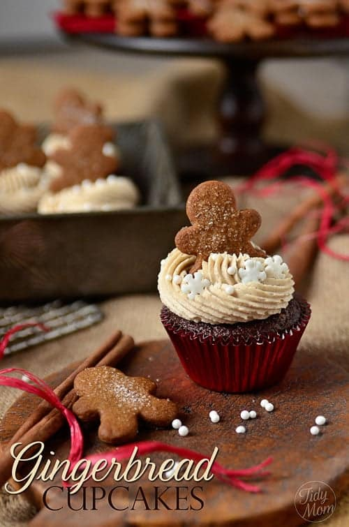 Spiced Gingerbread cupcakes with flavorful swirled frosting, candied snowflakes and mini gingerbread man topper