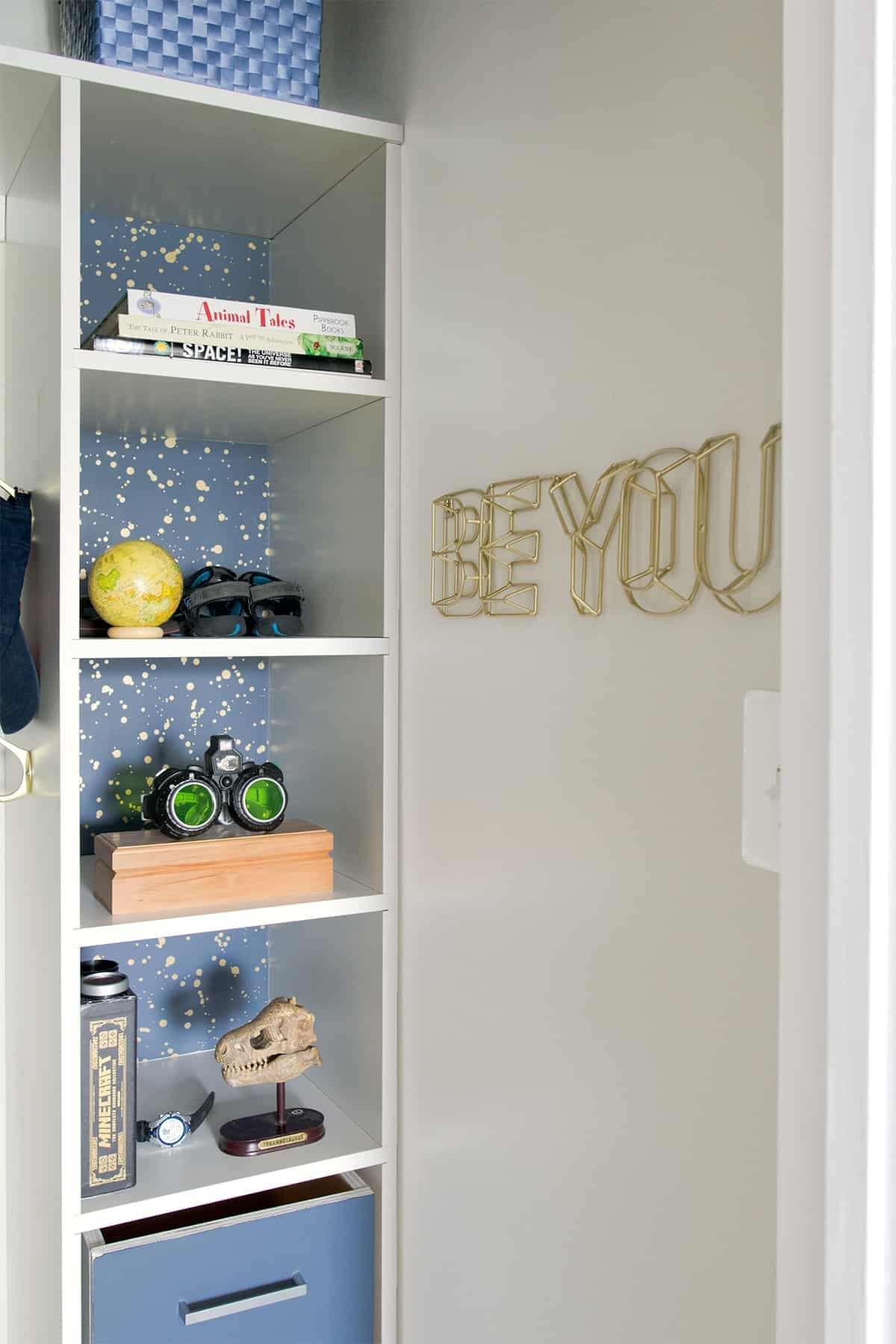 kid's closet organization with shelves closeup