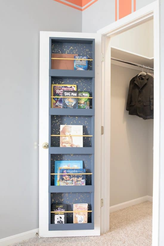 Book Storage rack on the back of a closet door.