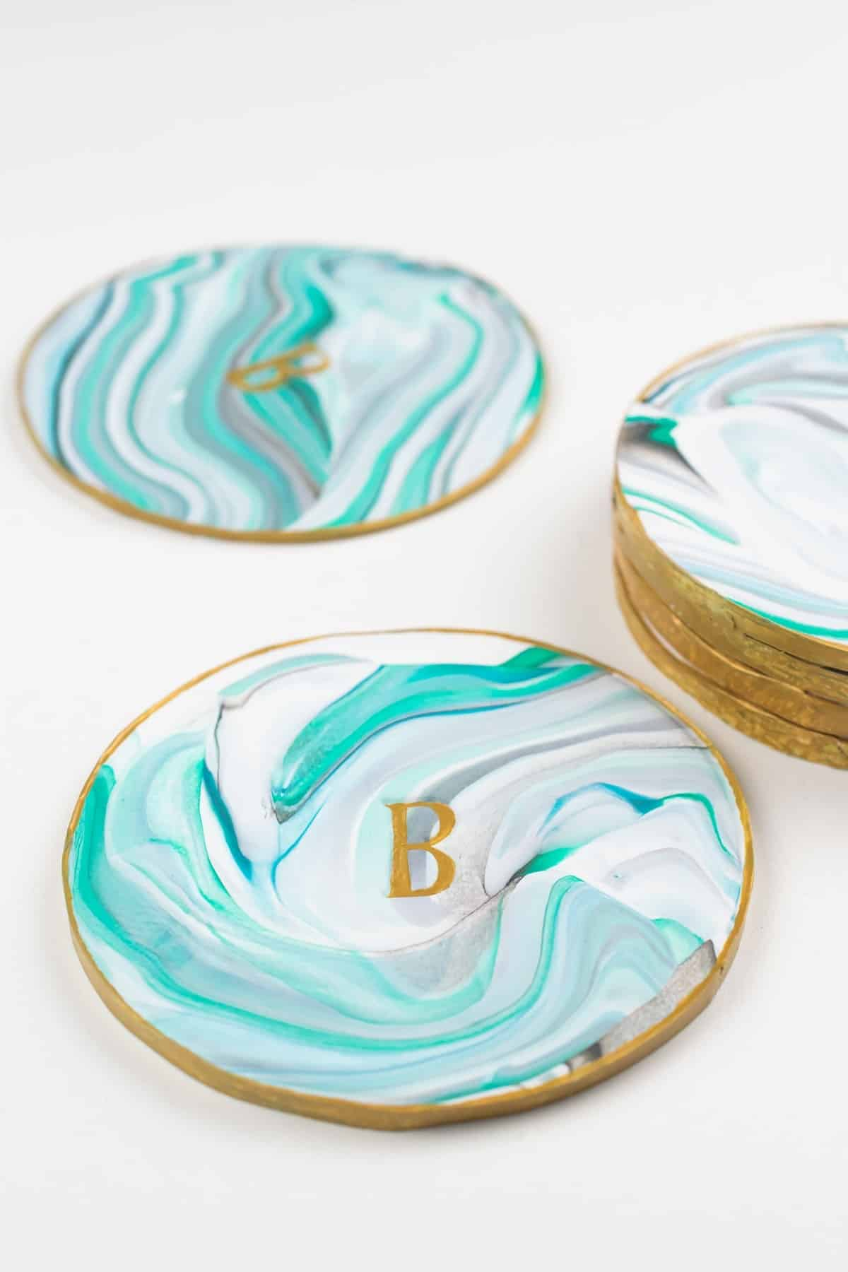 Blue and turquoise monogrammed handmade coasters with gold trim