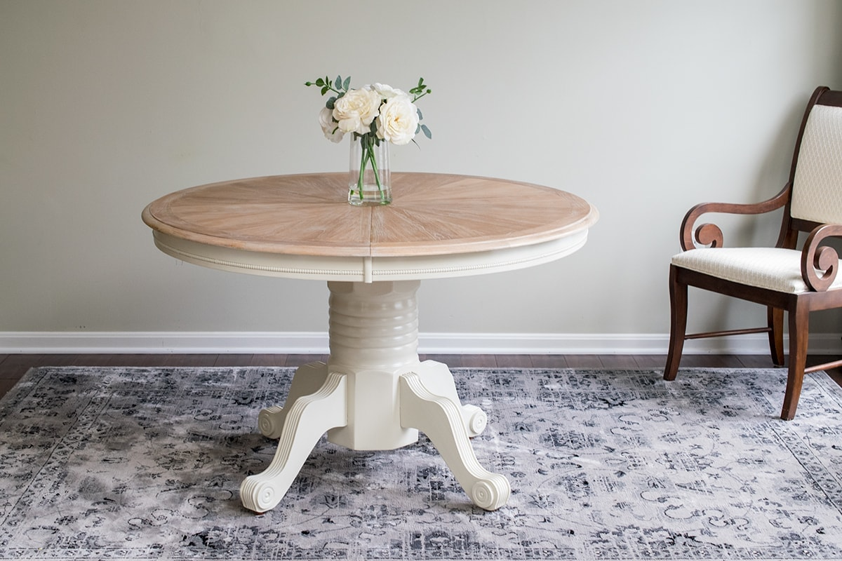 Finished cerused round dining room table without leaf insert