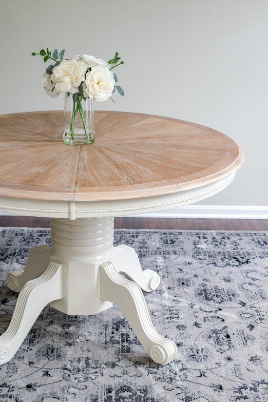 Cerused Table with flowers on top and a cream base.