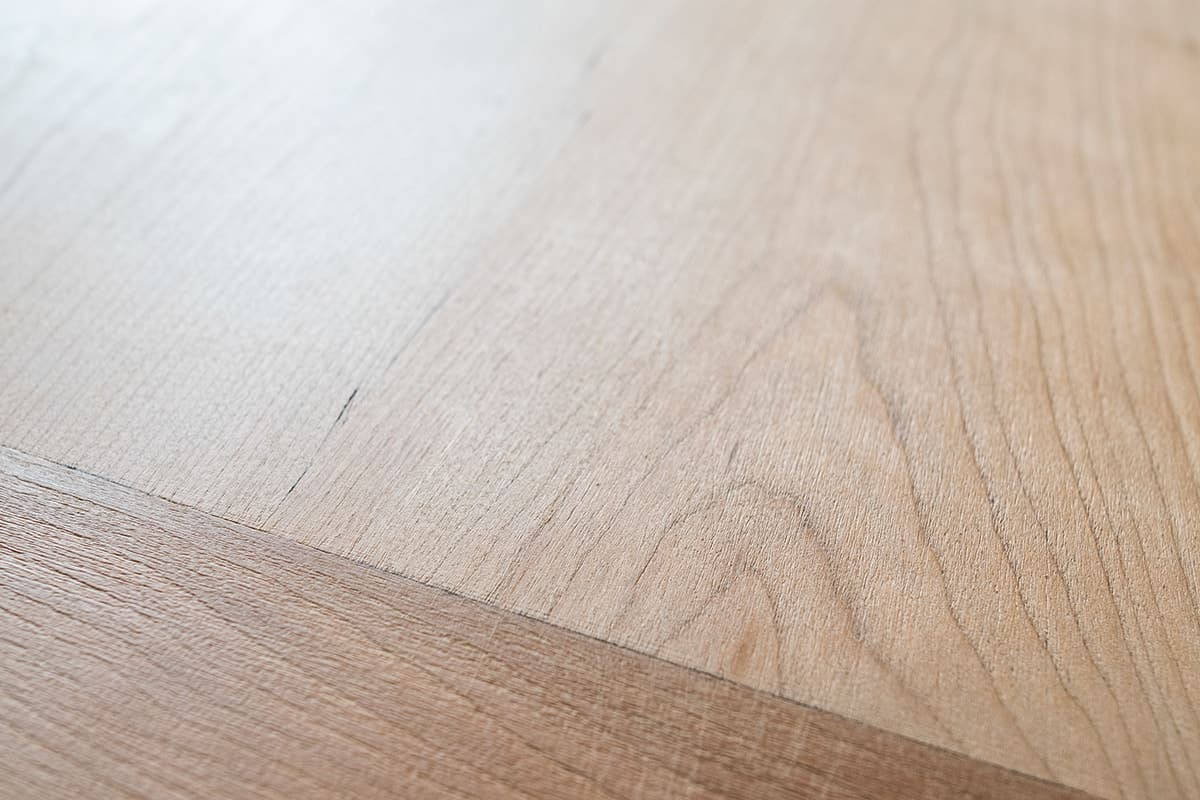 Closeup of stripped dining room table wood grain
