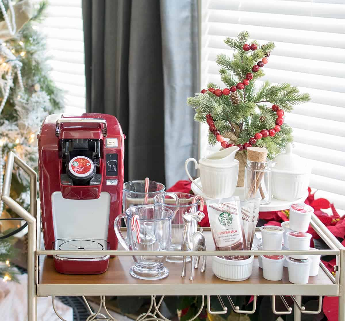DIY bar cart styling for red Kuerig coffee bar. Small Christmas accents on cart and in background.